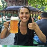 Girl, Antonia Washington, holding giant beer mug in Germany
