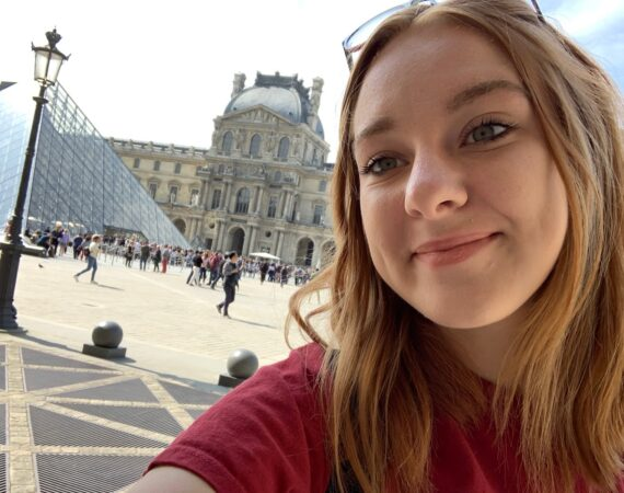 Girl takes selfie at the Louvre