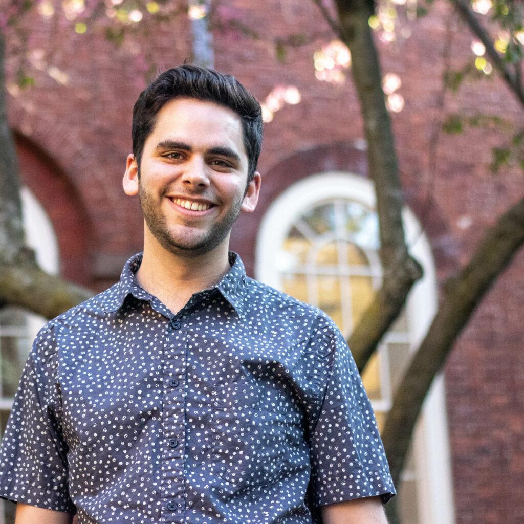 boy smiling in Harvard Yard