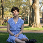 Girl sitting in Harvard Yard