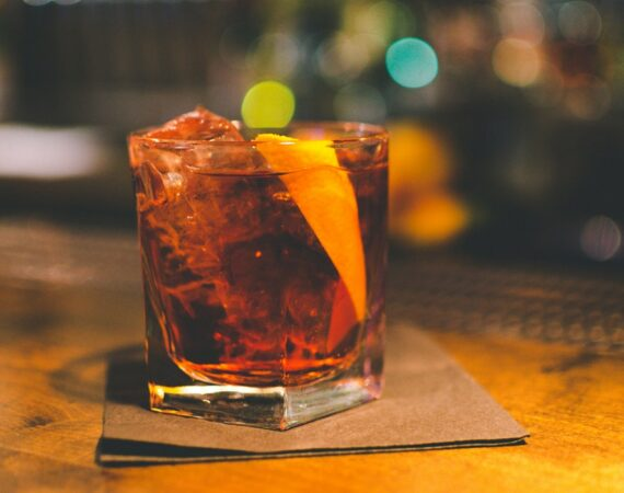 closeup of a negroni with orange peel