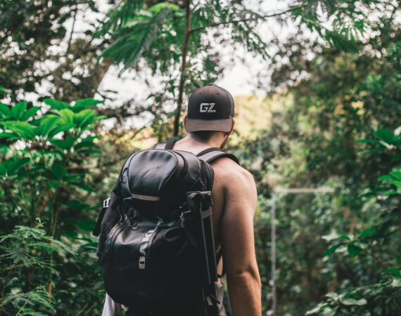 Man hiking in jungle hawaii