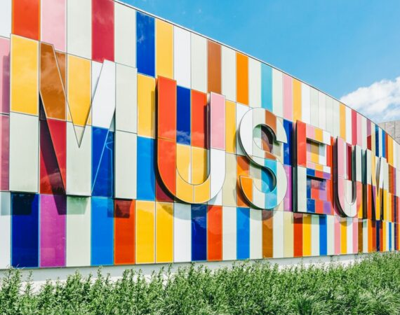 Museum sign with colorful blocks.