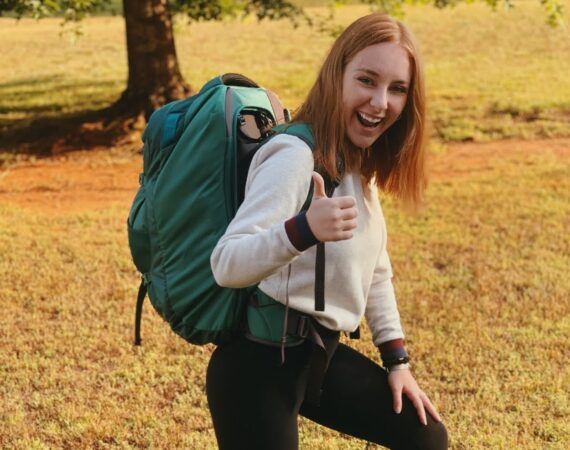 Girl backpacking and smiling