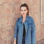 Girl in denim jean jacket ready to travel
