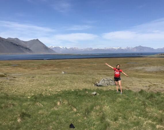 Girl standing in front of beautiful icelandic mountain background