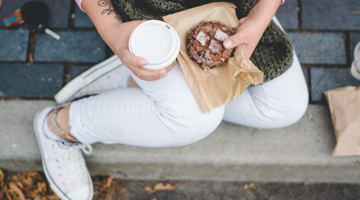 Woman eating coffee and pastry