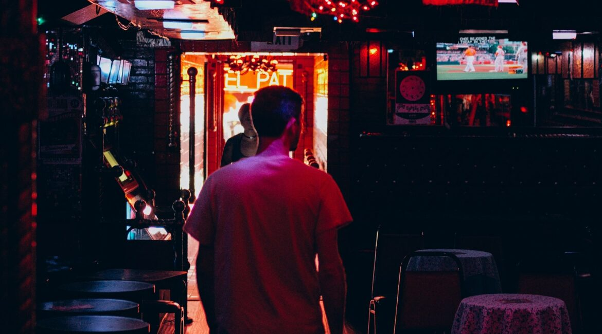 man walking in bar