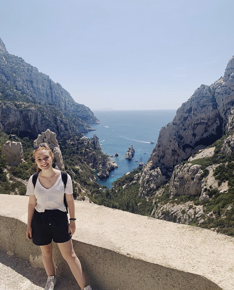 Girl standing in front of Calanques National Park